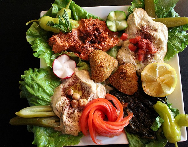 The vegetarian platter has hummus, batata harra, which is a potato dish, mohamara, a hot pepper dip, and baba ganoush along with fresh vegetables, pickles and falafel. It costs $15.25. - LEXIE MILLER