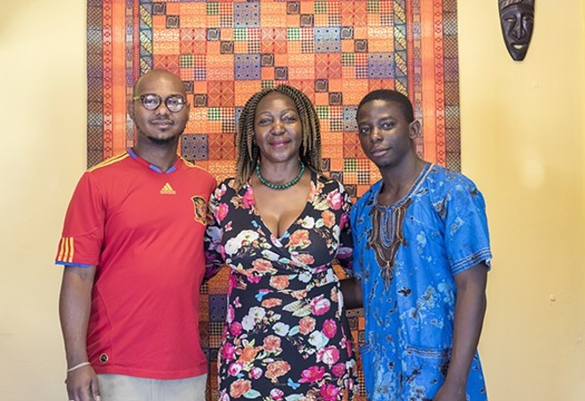 Chef Christine Mukulu Sseremba, with sons George Knudsen and Majesty Mukulu, is worried about what a massive redevelopment project on Olive will mean for her business. - MABEL SUEN