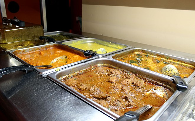 There are several meat options for lunch including chicken tikka masala, tandoori chicken and yellow dal. - LEXIE MILLER