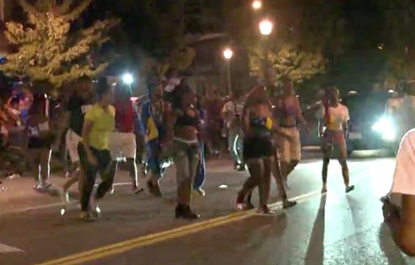 A KSDK cameraman films people fleeing as police disperse crowds in the Grove. - SCREENSHOT VIA KSDK
