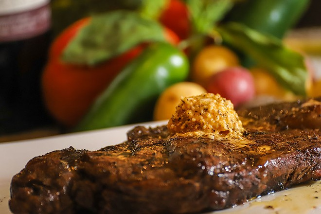 Steaks can be topped with house butters including garlic and herb, bleu cheese and garlic Parmesan. - GLENN REIGELMAN