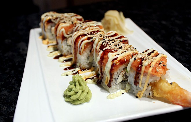 The signature Red Sun roll is cream cheese, shrimp tempura and crab topped with spicy mayo, spicy tuna and eel sauce for $10. - LEXIE MILLER