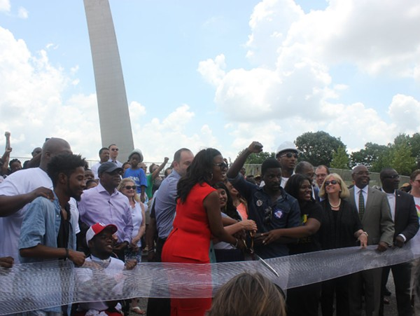 A diverse crowd cuts the ribbon on the Arch renovations - ALISON GOLD