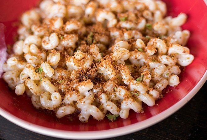 Mac and cheese uses cavatappi noodles and a four-cheese blend. - MABEL SUEN