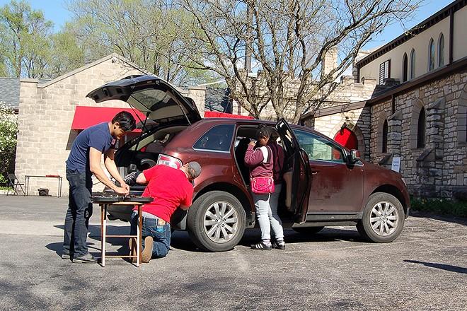 DSA members repair a brake light on April 28. - COURTESY OF DSA