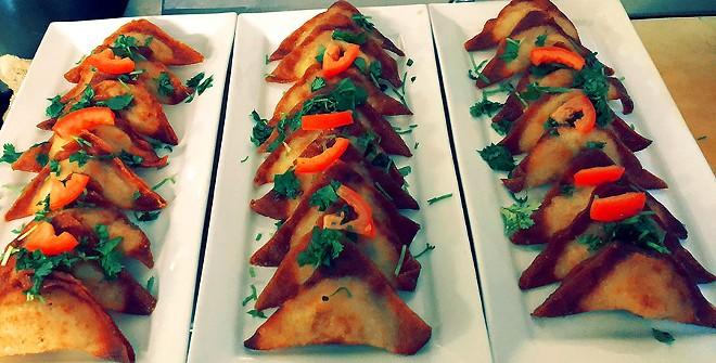Sambrosas are pastry dough filled with potato, cilantro and green onion. - AMEEN AKBARZADA