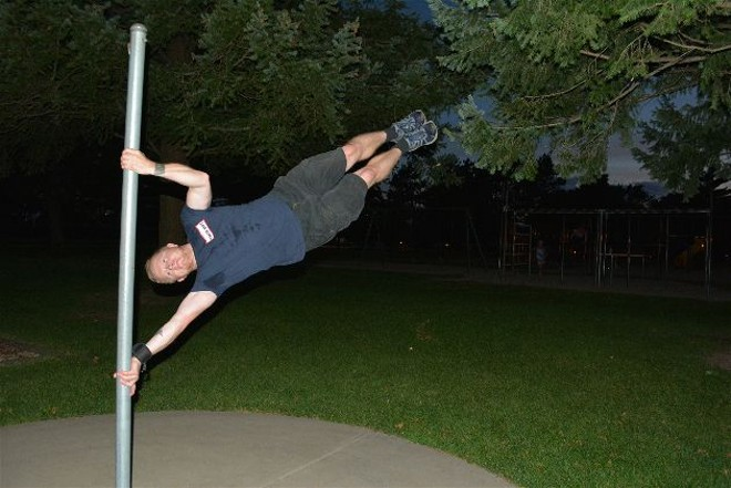 Jake Night displays some of the athleticism inherent in pole dancing on the family's backyard pole. - PROVIDED BY THE FAMILY