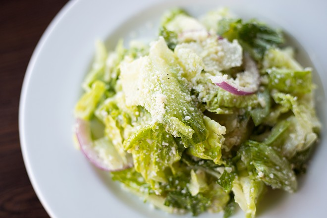 Del Pietro's signature salad incorporates red onions, provolone, Parmigiano cheese and red-wine vinaigrette. - MABEL SUEN