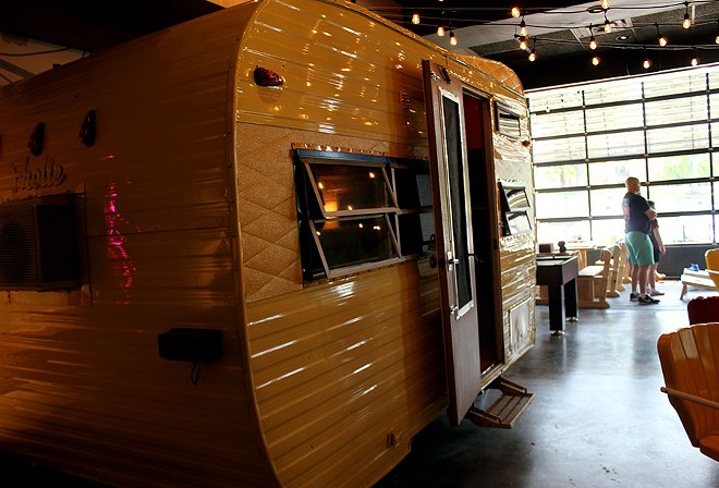 The camper sits in the dining room for guests to eat in. It was once owned by the rock band America. - LEXIE MILLER