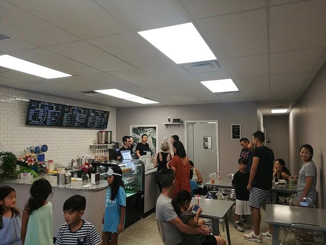 The staff works to keep customers fed. - IAIN SHAW