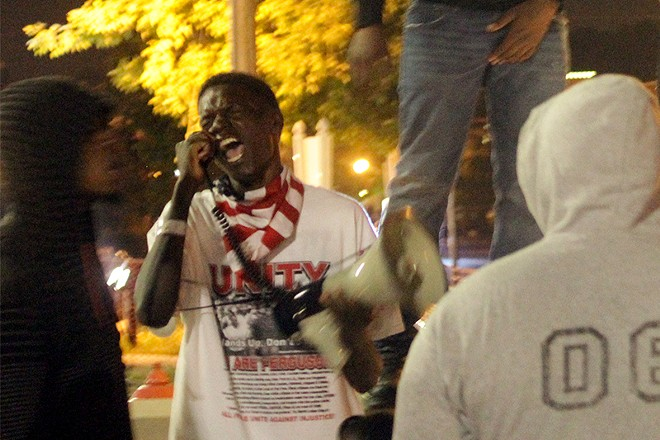Josh Williams leads a protest chant on September 26, 2014. - DANNY WICENTOWSKI