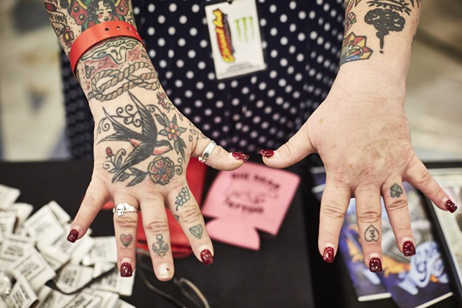 You can get flash tattoos similar to those on this woman's right hand at Trader Bob's Tattoo Flash Revival. - THEO WELLING