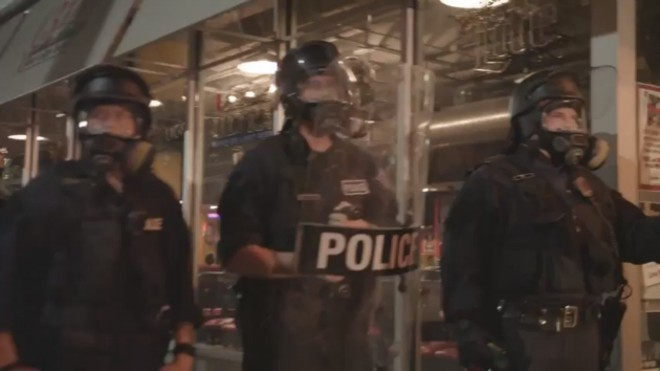 A video still from the kettle shows riot police walling off the intersection of Washington and Tucker. - DEMETRIUS THOMAS
