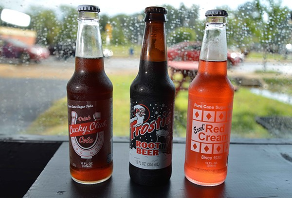 A variety of colorful pure cane sugar sodas available at Mike's are all from Excel Bottling of Breese, Illinois. - TOM HELLAUER