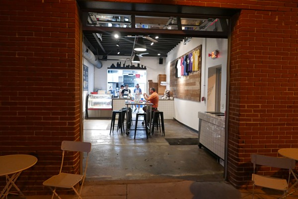The small shop has a communal vibe, with one large table in the center. - DESI ISAACSON