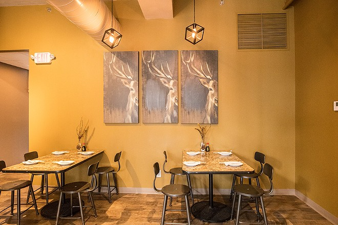 The main dining room features antler-themed decor. - MABEL SUEN