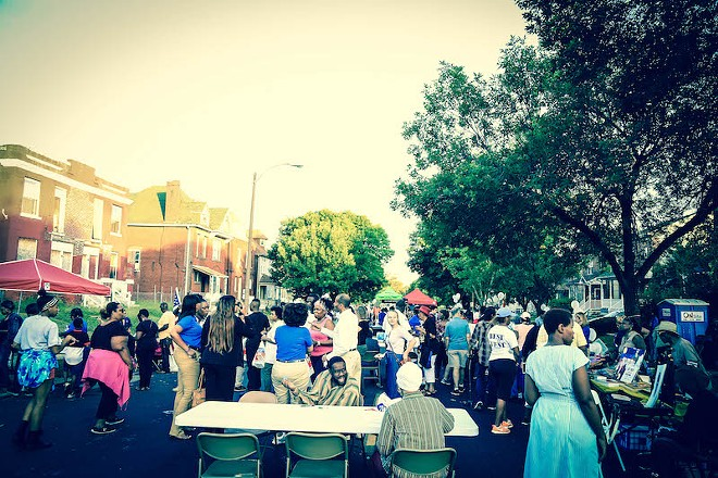 The neighborhood gathering included music and food from West End Grill & Pub. - NICHOLAS COULTER