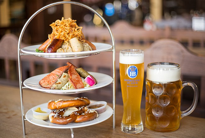 The sausage tower offers six sausages, two small pretzels, sauerkraut, German potato salad, two mustards and crispy fried onions. - MABEL SUEN