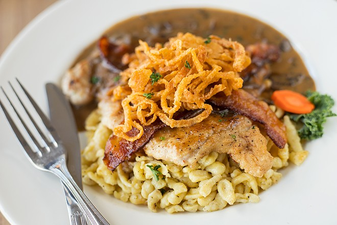 Jägerschnitzel is served with spätzle and cranberries. - MABEL SUEN