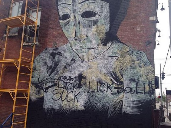 Faring Purth's mural on Sanctuaria after it was vandalized. - SEAN COLLINS