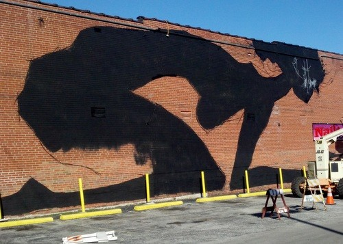 The beginning of Faring Purth's new mural on Cherokee Street. - ALLISON BABKA