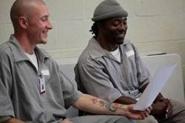 Melton and Williams rehearse with PPA during their free time. The grey jumpsuits are standard-issue for inmates at MECC. - COURTESY OF PRISON PERFORMING ARTS