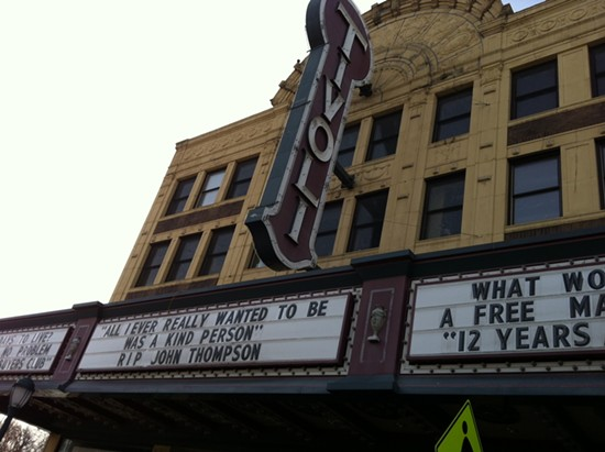 The Tivoli Theatre marquee pays special tribute to John Thompson. - PHOTOS BY LINDSAY TOLER