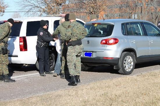 St. Louis County police arrest a protester in front of Monsanto headquarters in January.