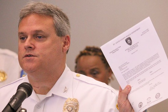 """St. Louis County Police Chief Tim Fitch holds a sample of the kind of letter police will be sending to the insurance companies of ticketed """"Ride of the Century"""" riders. - DANNY WICENTOWSKI"""