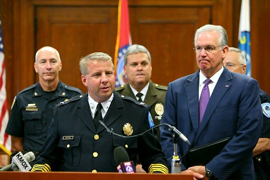 Police Chief Sam Dotson (front) with County Police Chief Tim Fitch (back) and Governor Jay Nixon. - FACEBOOK / SLMPD