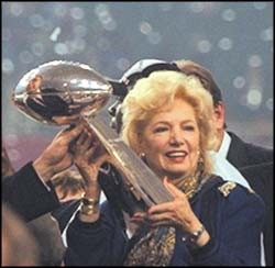 The late Frontiere, holdin' the Rams' Superbowl trophy