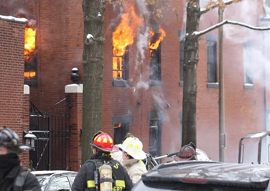 More than 50 firefighters battled the blaze in 18 degree weather. - UPI/BILL GREENBLATT