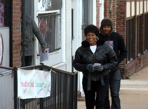 Stacey Hill, the mother of Stephon Averyhart, handed out flyers Thursday in the area where her son was shot and killed by two St. Louis metro cops last year. - DANNY WICENTOWSKI