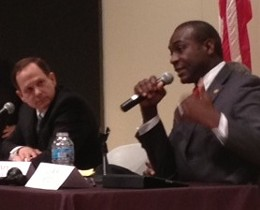 Francis Slay listens to opponent Lewis Reed at a debate last night. - SAM LEVIN