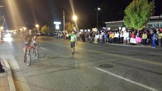 Peaceful, musical protesters in Ferguson Sunday night. - DANNY WICENTOWSKI