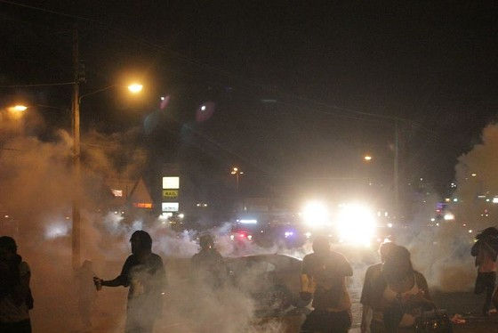Police fired both tear gas and smoke grenades at protesters Sunday night. - DANNY WICENTOWSKI