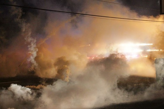 Police fired volleys of tear-gas canisters, flash-bang grenades and smoke bombs Sunday night. - DANNY WICENTOWSKI