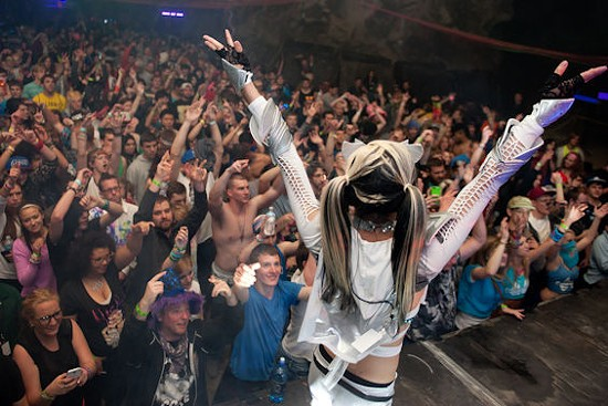 Thousands of people dance to dubstep, EDM and more at the cave rave. - JON GITCHOFF