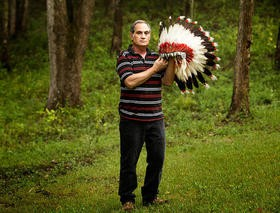 Kevin Airis and one of his grandfather's Native American headdresses. - JENNIFER SILVERBERG