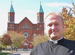 Pastor Marek Bosek outside St. Stanislaus - STANISLAUSKOSTKA.COM