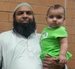 Raja Naeem and his youngest child. - COURTESY OF RAJA NAEEM