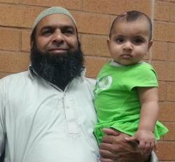 Raja Naeem and his youngest child. - COURTESY OF RAJA NAEEM