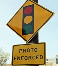 red_light_camera_sign_squat.jpg