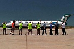 """Airport employees practice the """"Branson Wave."""""""