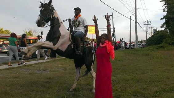 Hooves up! Django and Shiloh ride to honor Michael Brown. - RAY DOWNS