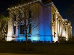 The Missouri History Museum shines in blue.