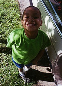 """Christian Ferguson in an undated photograph from the 1990s. Says his mother, Theda Thomas: """"Some people never knew he could walk and talk, how he loved to sing, how he prayed all the time."""""""