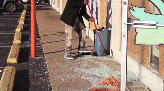Cleaning up at STL Cordless after a violent night of looting and vandalism. - SADIYYAH RICE