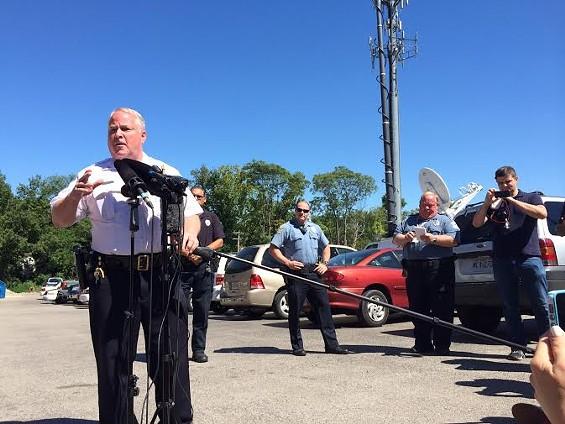 Ferguson Police Chief Tom Jackson talks to reporters. - LINDSAY TOLER