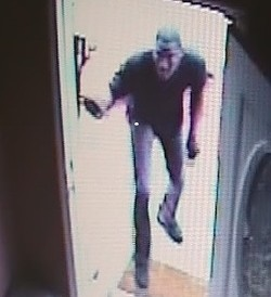 A suspect enters a house in Granite City after kicking in the door.